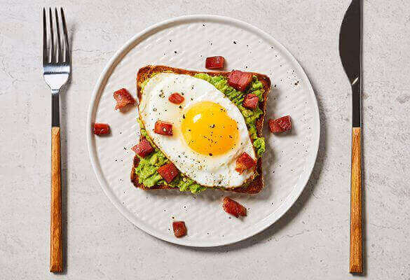 Avocado Toast with Egg and Crispy Pancetta on Country Grain - 700