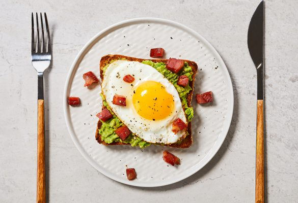 Avocado Toast with Egg and Crispy Pancetta on Country Grain - 850 x 630